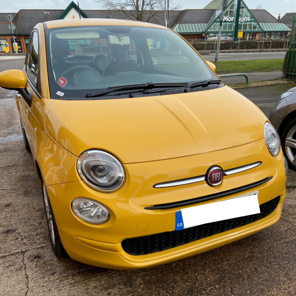 Picture of my new yellow Fiat 500 which  I have named Kevin.